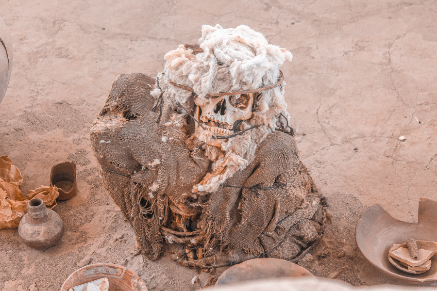 Mummified body at Chauchilla Necropolis, one of the many things to do in Nazca after flying over the Nazca lines.