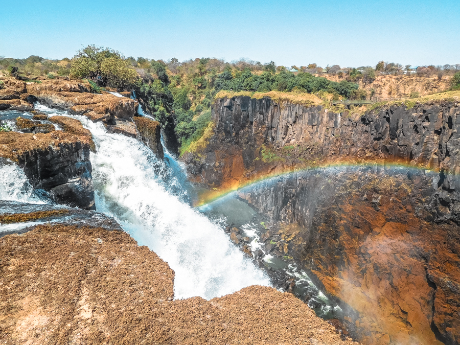 Water crashing down over the Zambezi River from atop Victoria Falls in Zambia. Interested in seeing this in real-life? Check out my guide on how to visit Victoria Falls on a budget