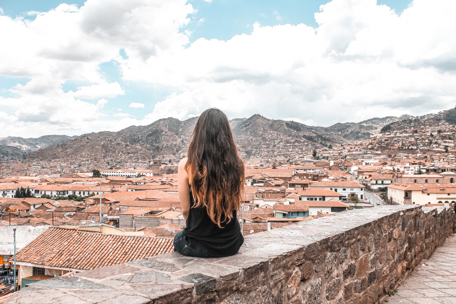 Overlooking Cusco's red rooftops before my day in Machu Picchu and how to get to Machu Picchu on a budget from Cusco