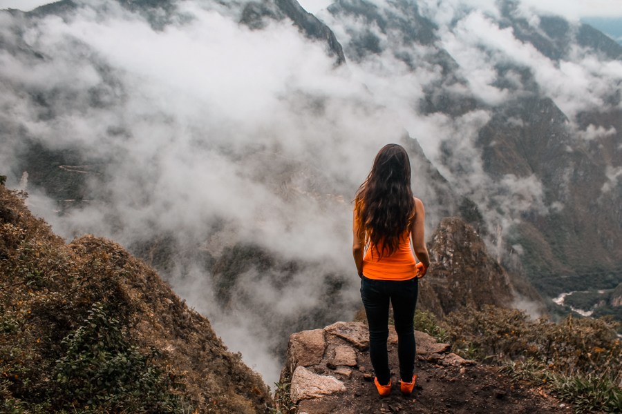 Overlooking Machu Picchu from Huayna Picchu Mountain. Interested in learning how to visit Machu Picchu on a budget? Check out my step by step guide on my blog! #Peru #MachuPicchu