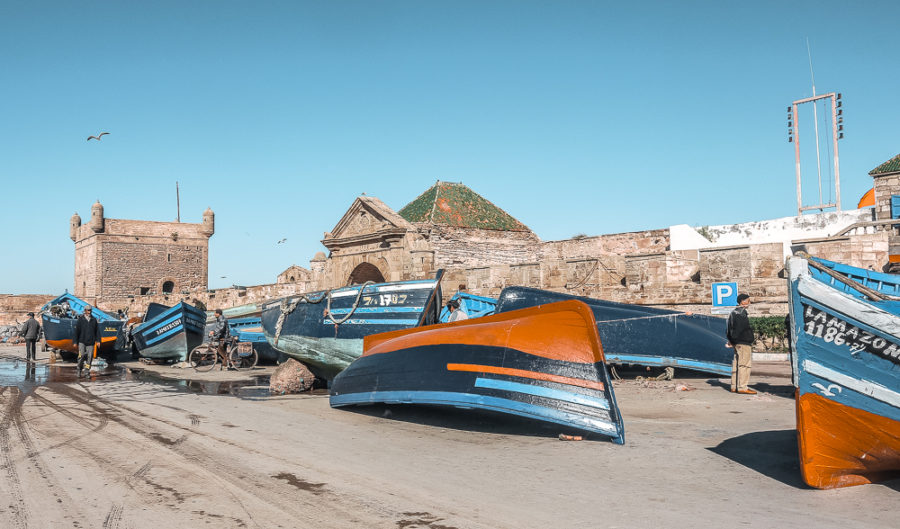 Boats galore at Essaouira's post. Looking for fun activities to do in Essaouira? Here's a travel guide to Morocco's boho town!