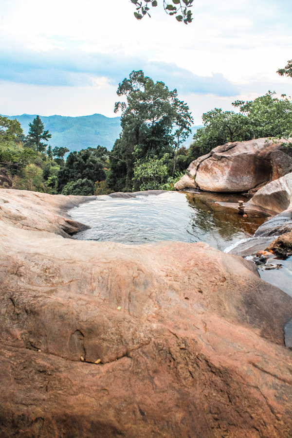 A visit to Ella, Sri Lanka isn't complete without taking a day trip to Diyaluma Falls and swimming at the top of Sri Lanka's highest waterfall!