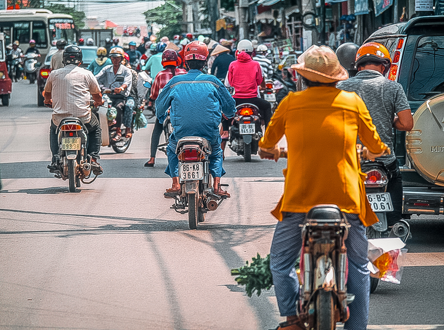 Scooters making their way through the traffic of La Gi in south Vietnam