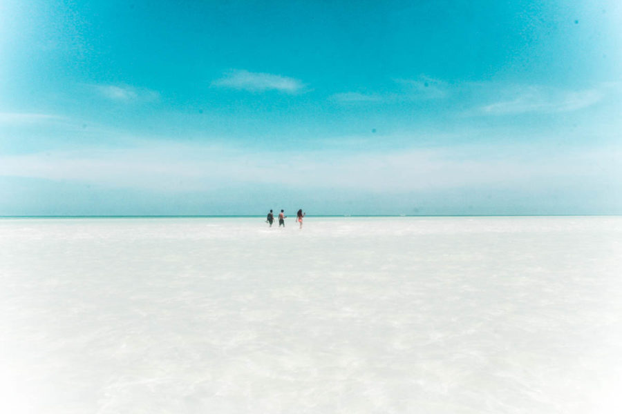 Walking on a salt bank to reach Punta Mosquito, one of the best excursions in Holbox