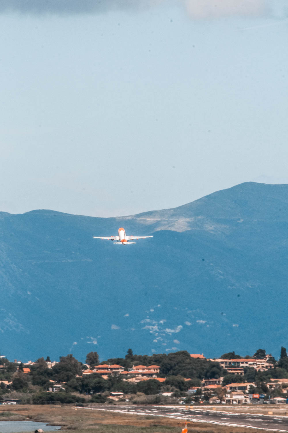 Watching planes taking off is a must on your Corfu itinerary